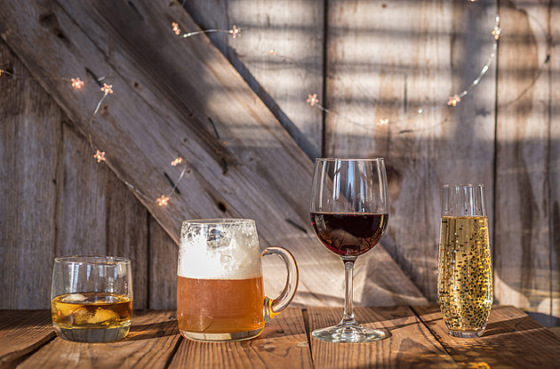 Beer wine champagne and scotch on rustic wood background